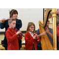 Pupils play with professional musicians