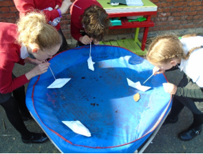 Year 6 demonstrating the effects of water resistance.