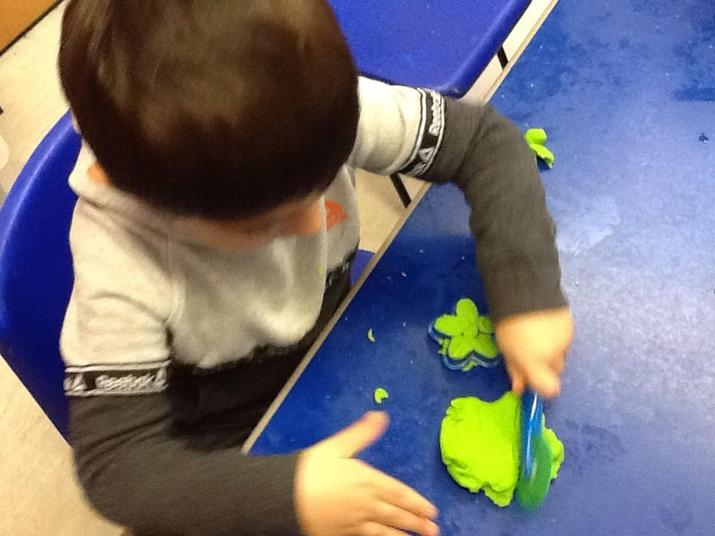 Cutting playdough with tools