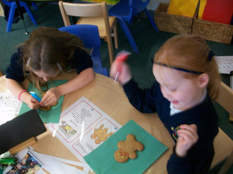 Decorating our gingerbread men!