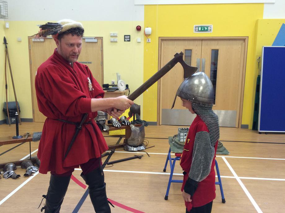 He showed us how an axe slides off a metal helmet!