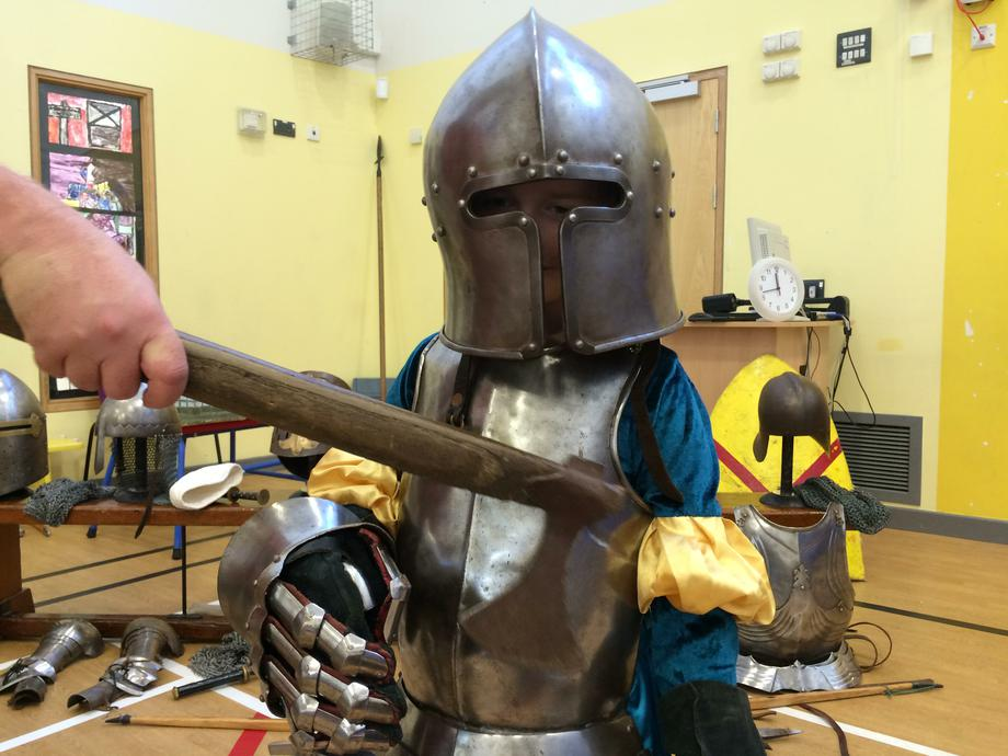 Tapping armour with a battleaxe...!