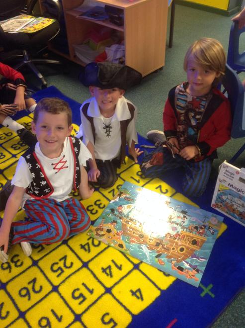 Working together to put the Pirate Puzzle together