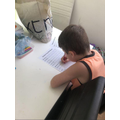 Leo practising his handwriting!