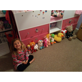 CC#2 - Neive and her lined up toys in height order