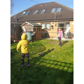 Ylli playing badminton outside.