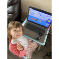 Lily-Rose is busy on her laptop