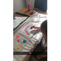 Olivia is painting a rainbow