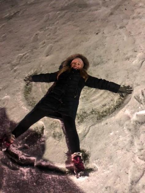 More snow fun - Madison making a snow angel