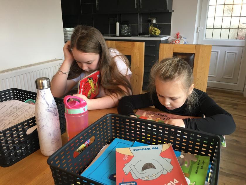 Lexi and Lola enjoying reading!