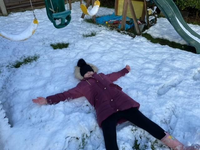 Lacey making a snow angel