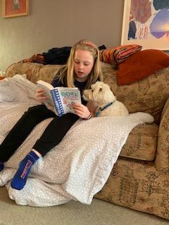 Eva reading to her dog Ronnie!