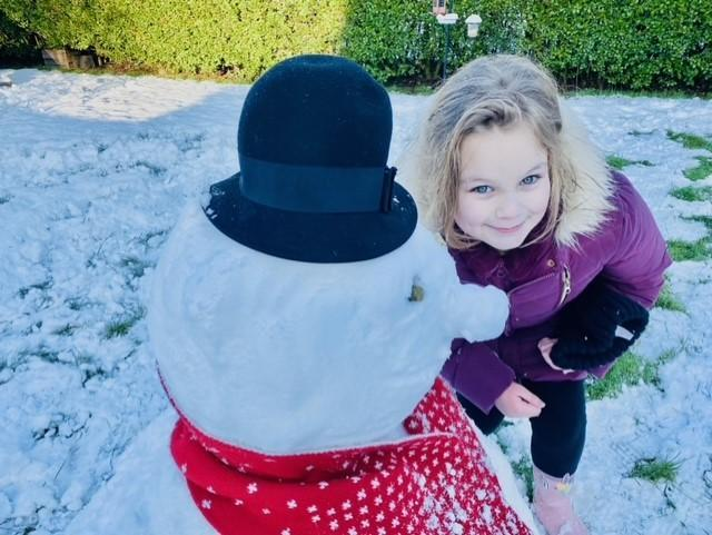Lacey and her snowman friend