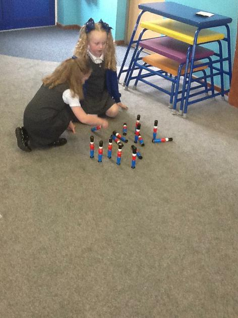 Subtracting by knocking down skittles