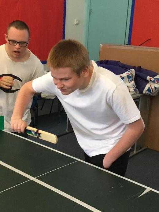 pupil playing table criciket