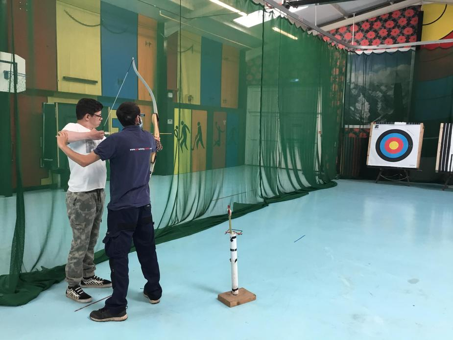 Pupil doing archery