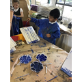 Experimenting with different shades of blue to make our own umbrella paintings
