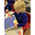 Making the Numicon fit.