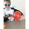 Orange and balloon experiment