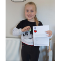 Lilly received a BLUE PETER badge for being Eco!