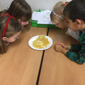 Looking at different shapes of pasta.