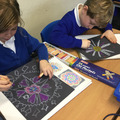 Designing & drawing Rangoli Patterns in oil pastel