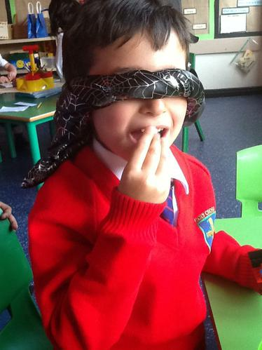 We were blind folded and had to use our sense of taste and touch to help us identify what item of food we were tasting.