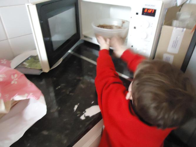 Using the microwave to melt chocolate.
