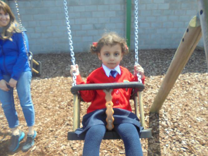 Talah enjoyed the swings.