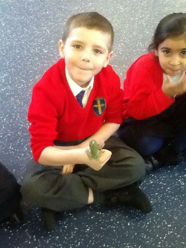 Freddy the frog enjoyed sitting on Jack's thumb.