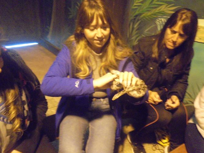 Miss Rice held a wriggly snake.