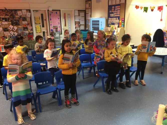 The parishioners sing from their hymn books