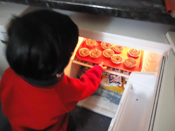 Using the fridge to chill our cakes.