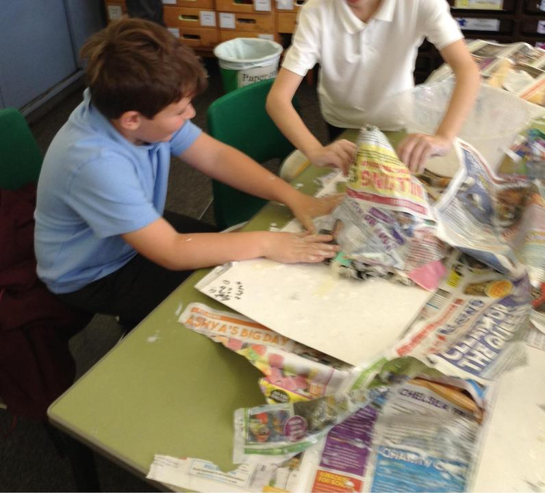 We used paper mache to form our volcanoes.