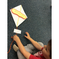 Taping happy words to kites.