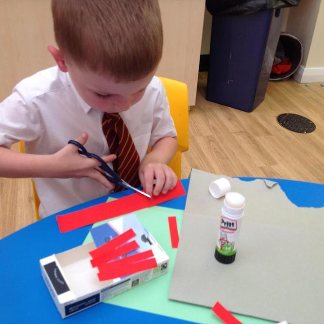 We made our own hen houses. We used our scissor skills to cut.