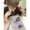 Manipulating clay.
