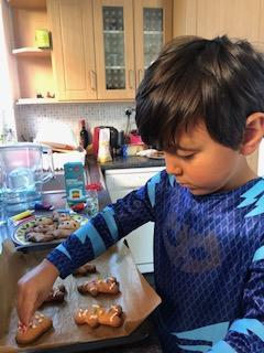 Giovanni decorating his gingerbread men