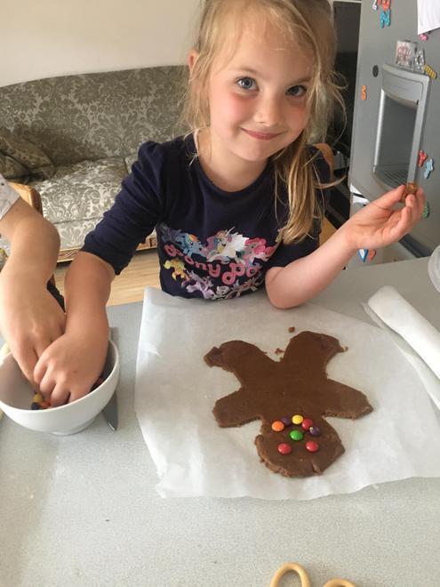Bianca decorating her gingerbread man
