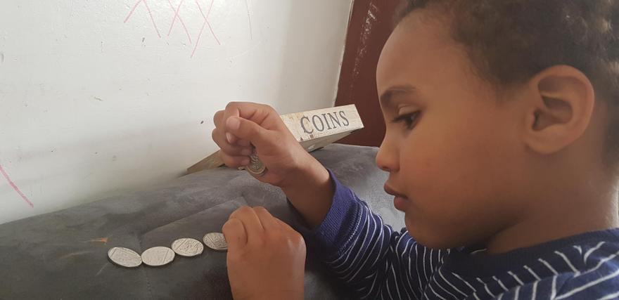 Elis learning about money