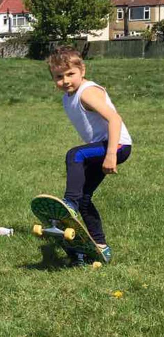 Maksim learning to skateboard