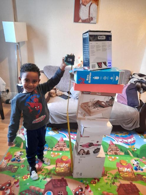 Jonathan measuring his tower