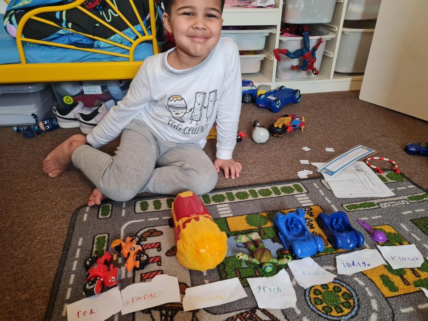 Gabriel makes a rainbow using his toys