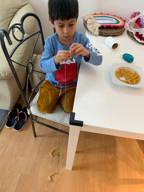 Mateo B - threading pasta shapes for 1 minute