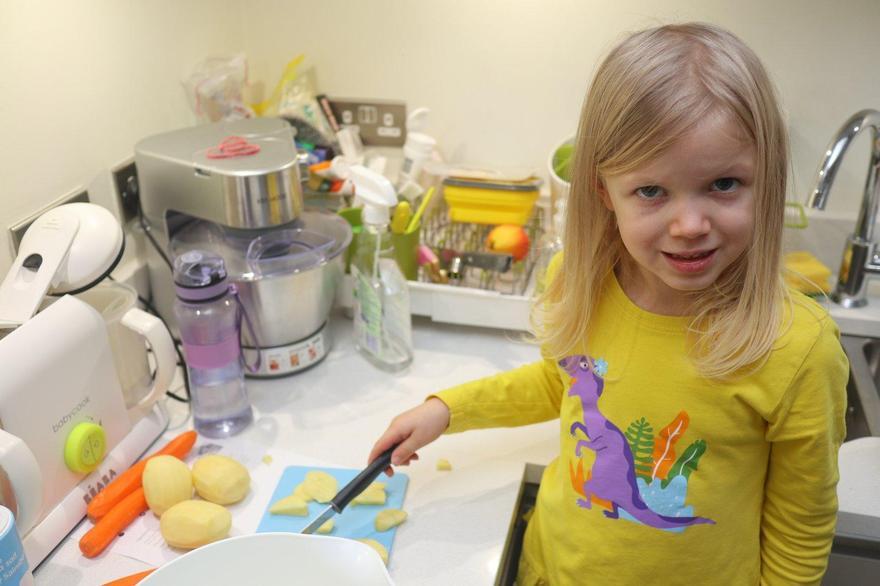 Laura making vegetable soup