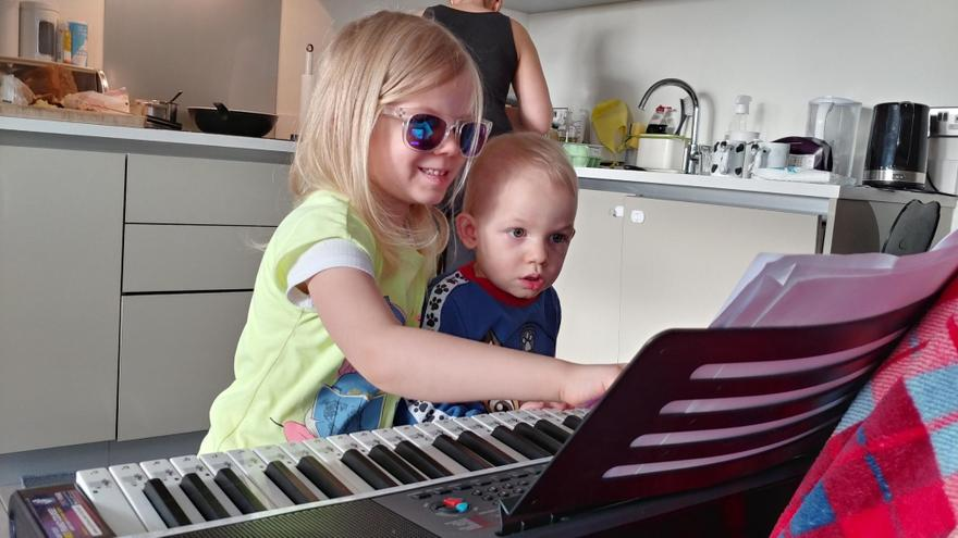 Laura learning the piano