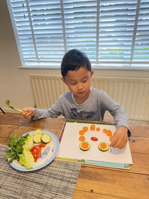 Mason making his fruit and vegetable face