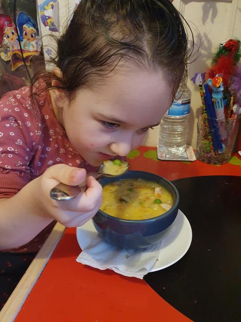 Goda tasting her vegetable soup