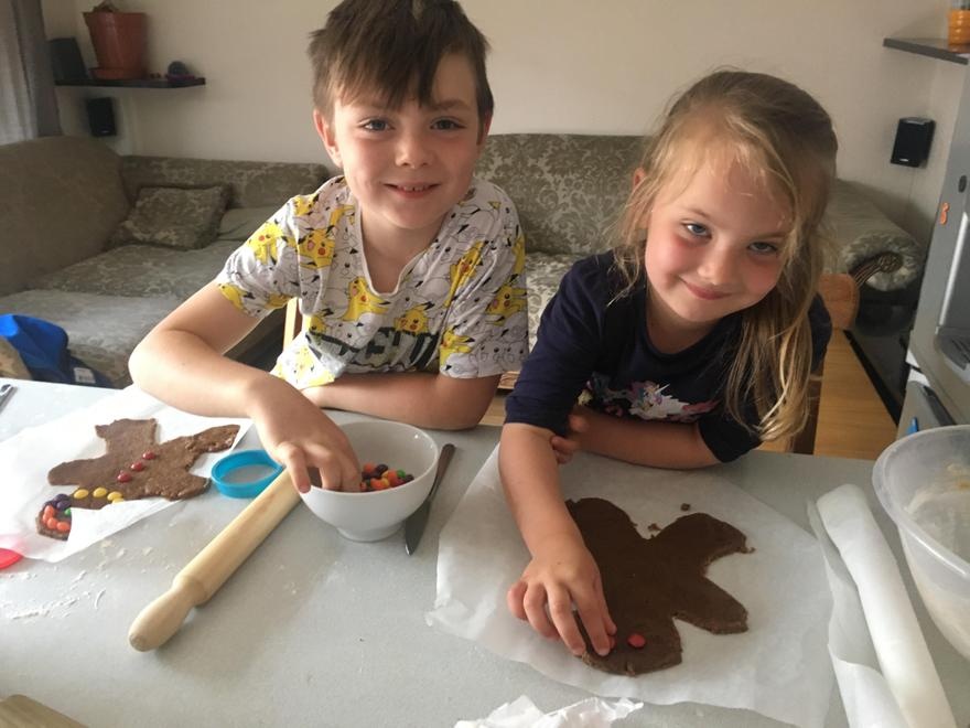 Bianca making a gingerbread man with her brother