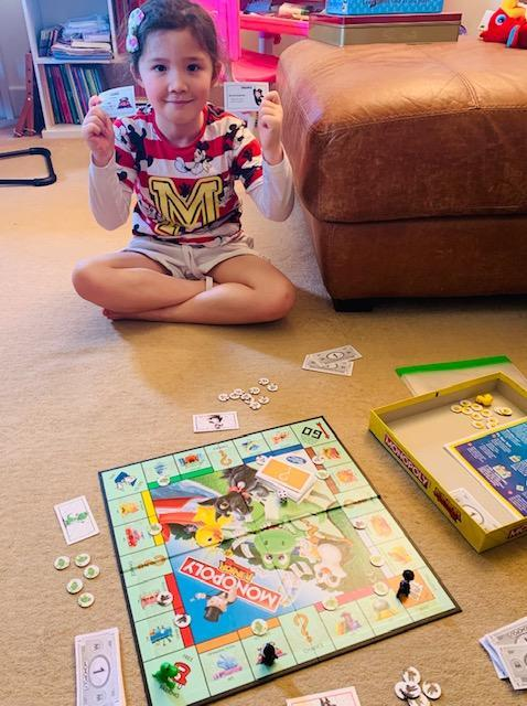 Elena Playing Monopoly